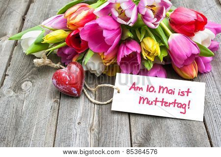 Tulips with tag and german text for mother's day