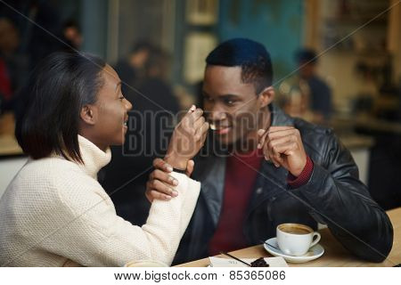 Two people in cafe enjoying the time spending with each other good friends talk and drink coffee