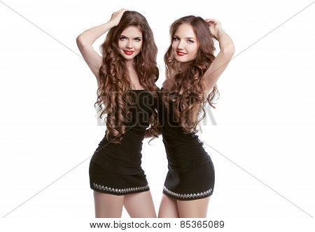 Two Beautiful Women Friends Laughing And Dancing With Long Wavy Hair Posing Isolated On White Backgr