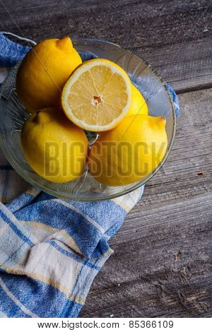 Lemons On Old Wooden Table