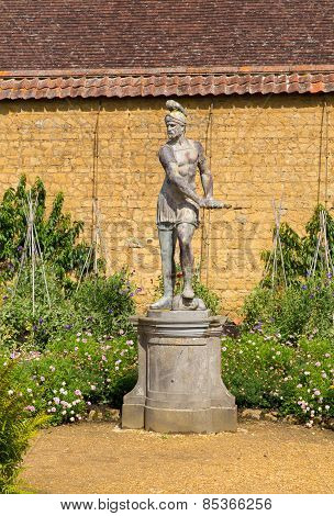 Statue in gardens at Barrington Court near Ilminster Somerset England uk Tudor manor house