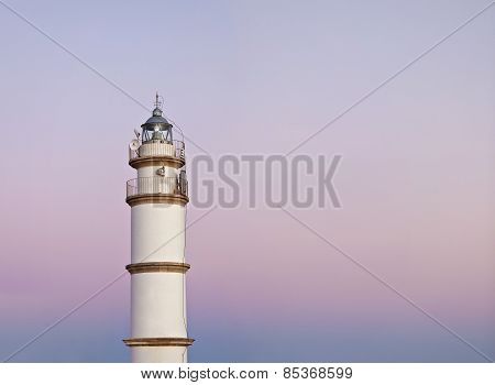 Gently Colorful Sky At Sunset With Lighthouse