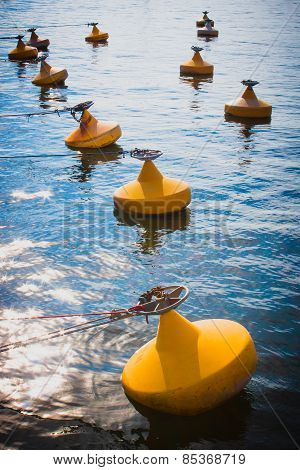 Yellow anchor buoy on the water
