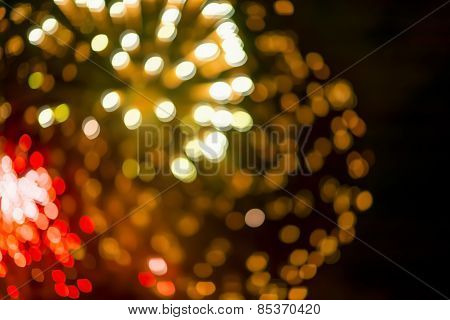 Blurred lights from fireworks, black background