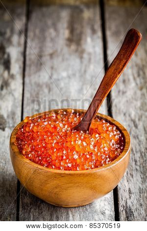 Fresh Red Caviar In A Wooden Bowl With A Spoon