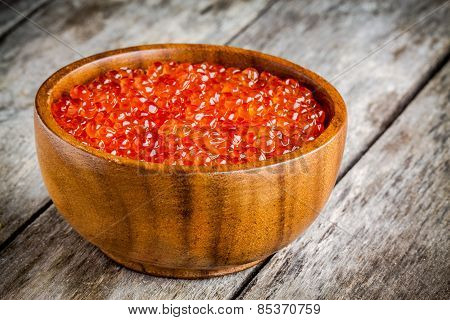 Fresh Red Caviar In A Wooden Bowl