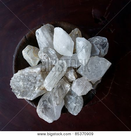 Crystals in a wooden bowl