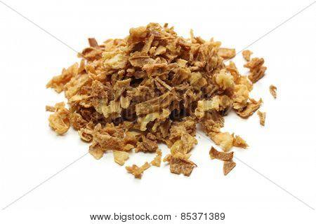 crispy fried onion flakes on white background