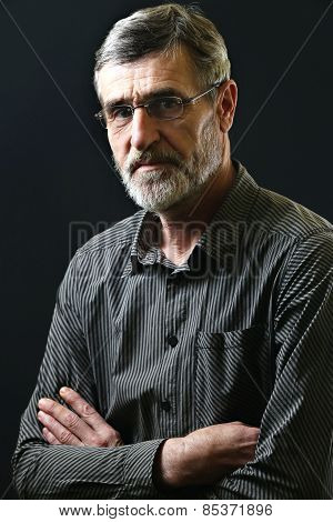 Portrait of a casual middle aged man in striped shirt