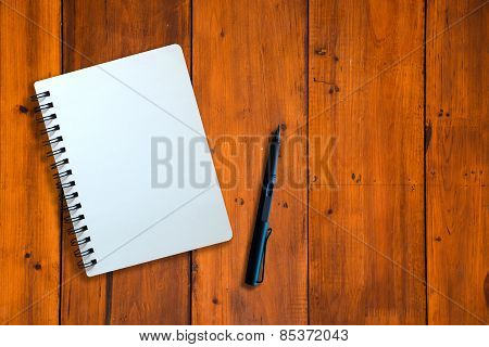 Notebook And Pen On Wood Pattern