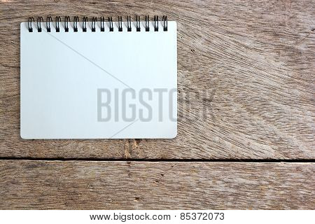 Page Of Notebook On Wood Texture