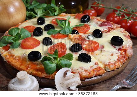 Pizza With Cheese, A Salami, Mushrooms, Tomatoes, Olives And Rucola
