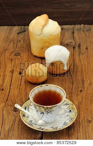 Kulichi, Traditional Russian Easter Cake With Icing, Cup Of Black Tea On Wooden Background
