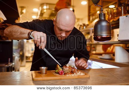 Chef in a black uniform jacket
