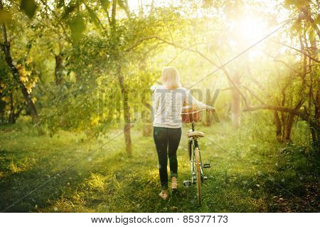 Blurred Image Of Female With Bicycle