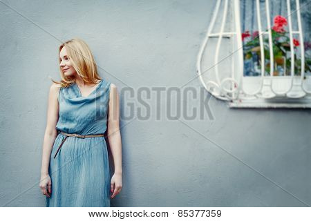 Fashion Portrait Of Young Woman Near Wall
