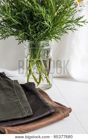 Pants Of Various Colors On White Wooden Table