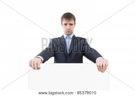 sad businessman holding a white blank