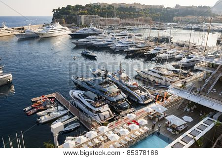 MONTE CARLO, MONACO - OCTOBER 3, 2014: Port Hercules with luxury yachts in Monaco viewed from seaside gardens near casino.