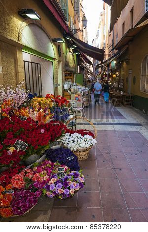 NICE, FRANCE - OCTOBER 2, 2014: Walking pedestrian Rue Pairoliere, a quaint shopping street lined with food shops and cafes, is a great way to experience authentic Nice.