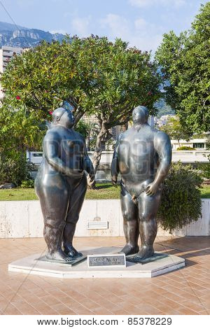 MONTE CARLO, MONACO - OCTOBER 3, 2014: Adam and Eve sculpture by Fernando Botero in casino gardens, Monaco