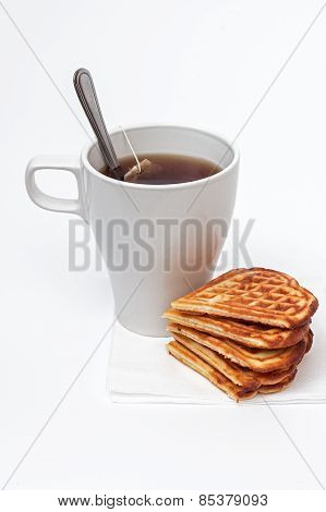 Homemade waffles and a cup of tea.