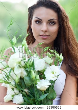 Beautiful Woman In Field With Flowers