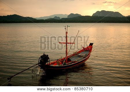 Traditional Fisherman Long Tailed Boat In Koh Phitak Island, Thailand At Sunset.