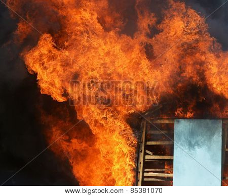 A Wooden House In Flames