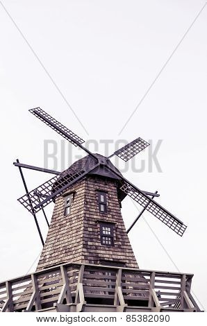 Windmill standing in white isolated background