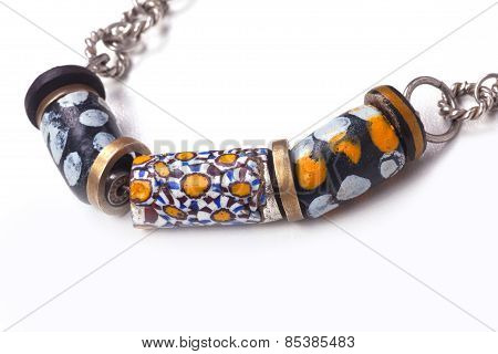 Close Up Of Silver And Painted Stone Necklace
