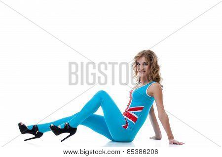 Studio photo of beautiful dancer in tight jumpsuit
