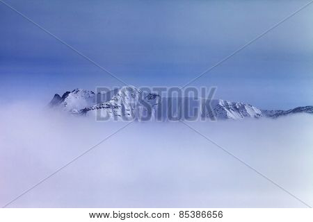 Snowy Mountains In Fog