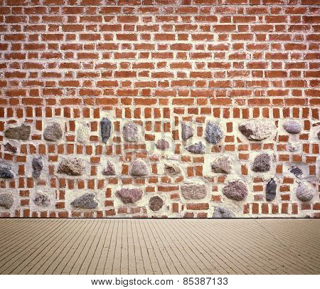Light brown brick wall texture with sidewalk.