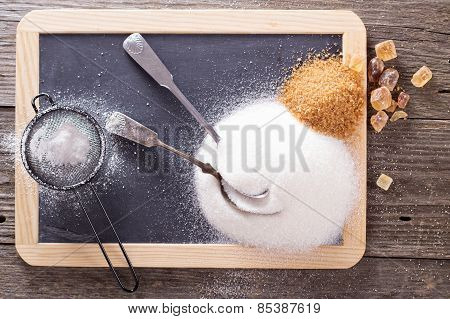 Variety of sugars on a chalkboard