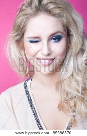 Young attractive blonde winking woman expressive portrait beauty concept