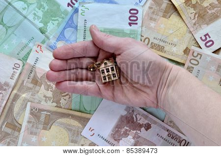 Money And A Hand With A House