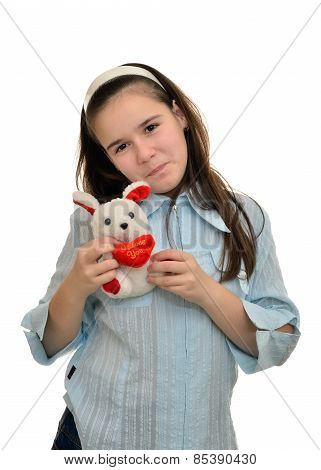 Teen girl holds favorite toy hare