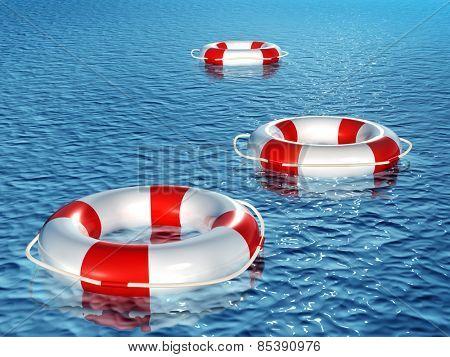 Three 3d lifebuoys, floating on waves