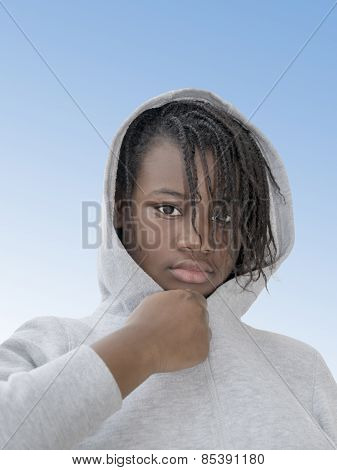 Preteenager wearing a hooded sweatshirt