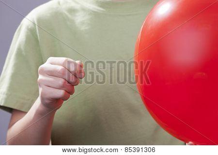 Popping A Balloon.