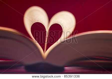 Blurry Heart Made From Book Pages Over Red Background
