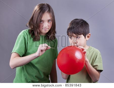 Popping Brother's Balloon.
