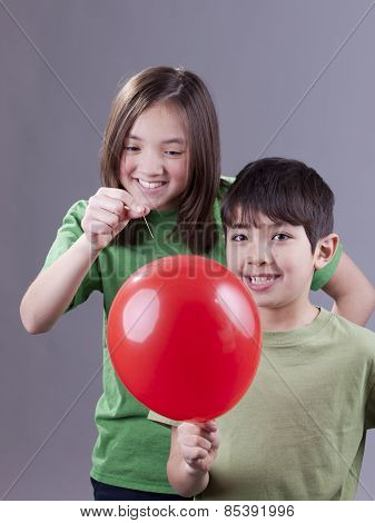 Popping Her Brother's Balloon.