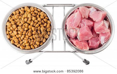 Meat And Dry Food For Pets In Metal Bowls