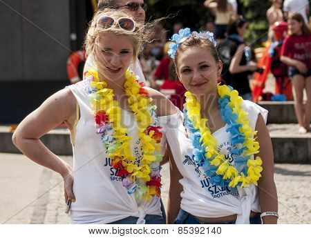 Two College Girls With Beach Toys And Hawaii Garlands