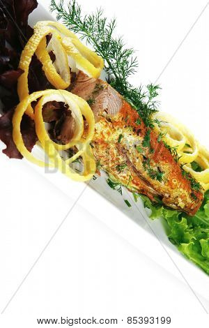 roast tuna steak served on white ceramic dish