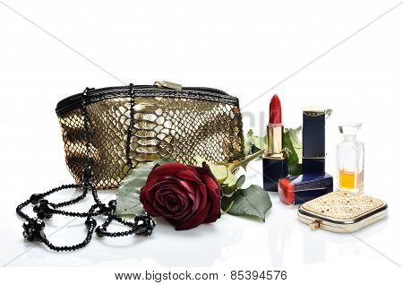 Items for decorative cosmetics, makeup, mirror and flowers