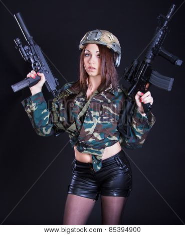 Woman In The Military Uniform With Assault Rifles