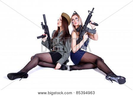 Two Women In The Military Uniform With Guns